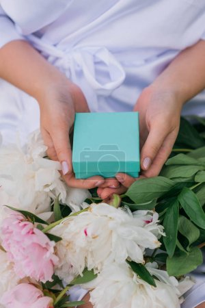 Photo for Partial view of bride hands holding box with wedding ring - Royalty Free Image