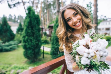 beautiful bride with white bouquet