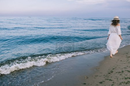 girl goes along the shoreline