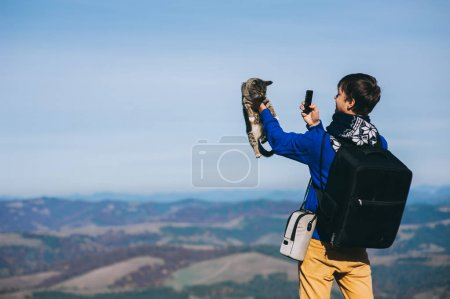 tourist and cat on  mountain