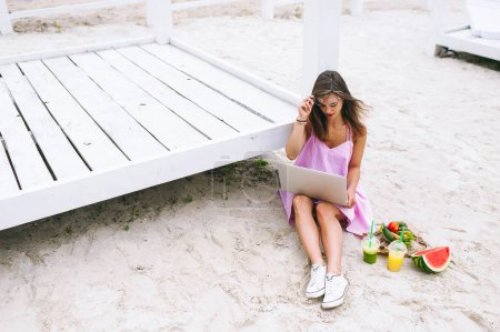 beautiful girl works with a laptop