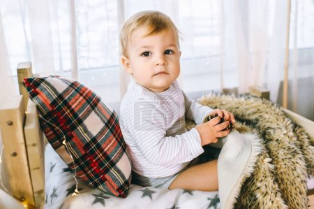 little boy holding pine cone