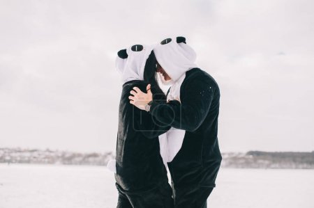 young couple in pandas suits