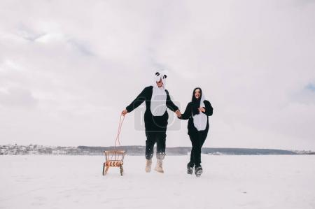 couple in suits pandas