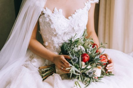 Beautiful wedding bouquet in hands of the bride, close-up view