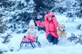 Happy family with dog in winter park