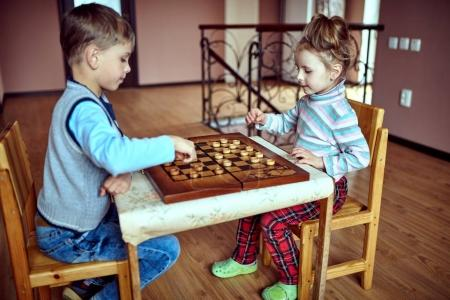 Photo for Two children playing in checkers at kindergarten - Royalty Free Image