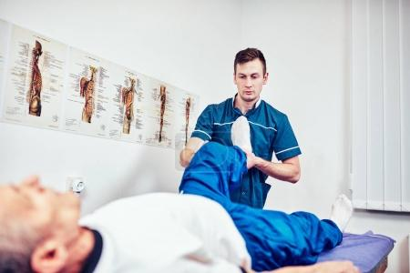 Photo for Senior man on a physiotherapy session - Royalty Free Image