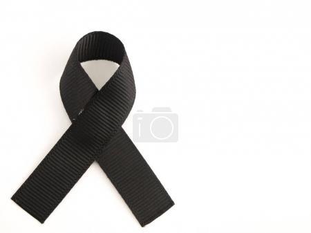 Black ribbon awareness on white background