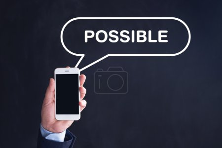 Photo for Hand Holding Smartphone with POSSIBLE written speech bubble - Royalty Free Image