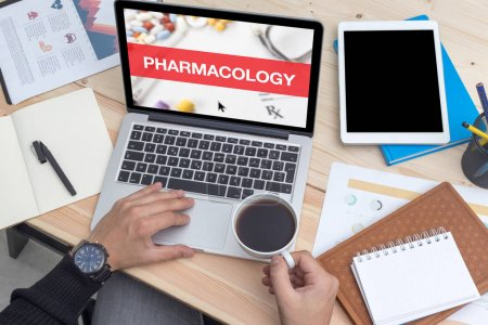 PHARMACOLOGY CONCEPT ON LAPTOP