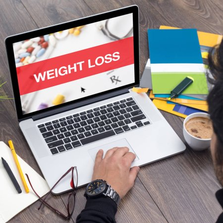 Photo for WEIGHT LOSS CONCEPT ON LAPTOP SCREEN - Royalty Free Image