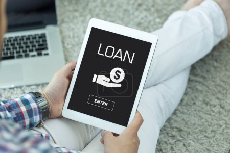 Photo for LOAN CONCEPT on screen of device - Royalty Free Image