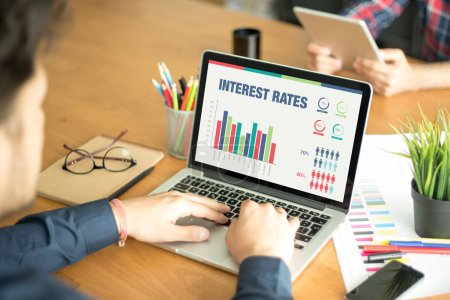 Photo for Business Charts and Graphs on screen with INTEREST RATES Title - Royalty Free Image