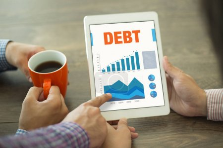 Photo for Business Charts and Graphs on screen with DEBT Title - Royalty Free Image