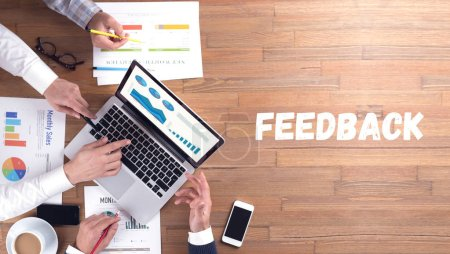 FEEDBACK concept, professionals at work