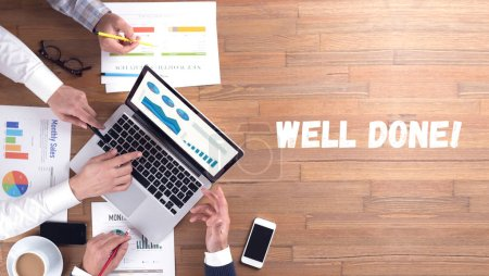WELL DONE! word concept on desk background
