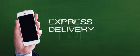 Photo for Smartphone in hand in front of blackboard and written  EXPRESS DELIVERY - Royalty Free Image