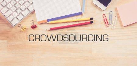 Photo pour Business Workplace avec signes de Crowdsourcing - image libre de droit