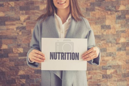 Woman presenting NUTRITION CONCEPT