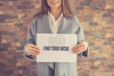 Woman presenting FIND YOUR NICHE CONCEPT