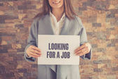 Woman presenting LOOKING FOR A JOB CONCEPT