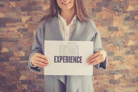 Woman presenting EXPERIENCE CONCEPT