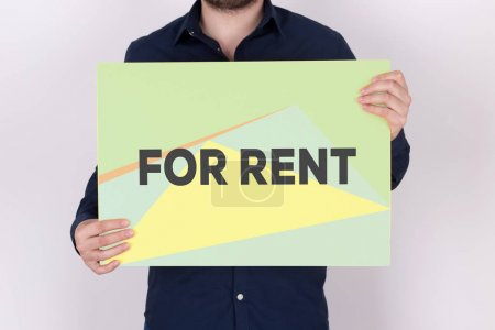 Photo for FOR RENT CONCEPT. Man holding billboard - Royalty Free Image
