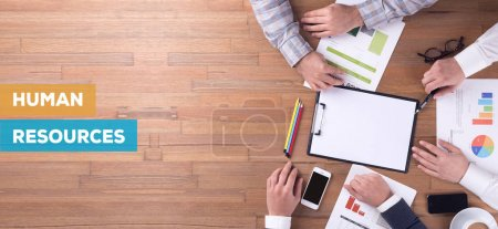 Photo for HUMAN RESOURCES CONCEPT. Businesspeople working at desk - Royalty Free Image