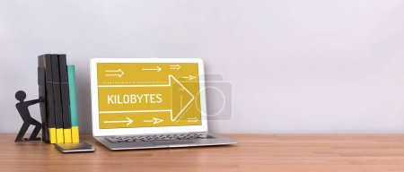 KILOBYTES CONCEPT on screen of  Laptop on wooden d...