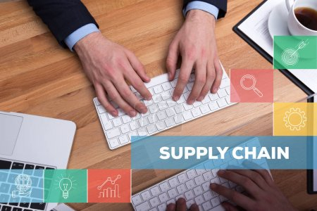 Photo for SUPPLY CHAIN CONCEPT. Businessmen working at desk - Royalty Free Image
