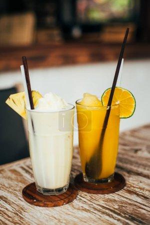 fresh made milkshake and orange juice