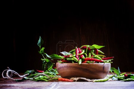 Small hot peppers in a wooden bowl