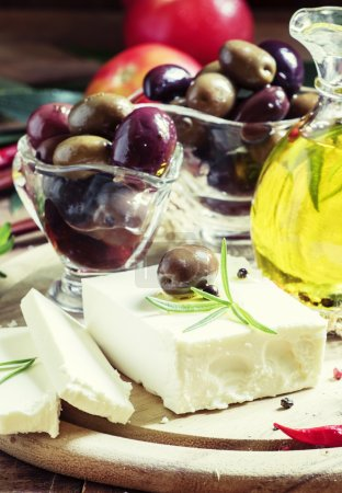 Soft greek feta cheese with rosemary, olives and butter