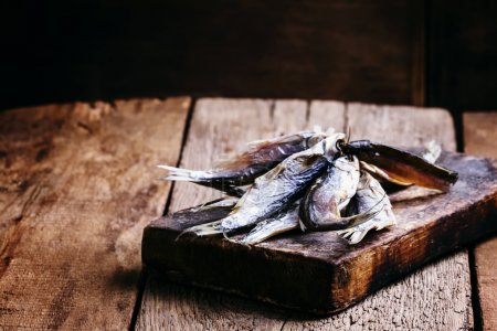 Dried fish. Vintage wooden background