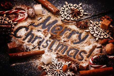 Christmas background with winter spices, cocoa powder and sugar
