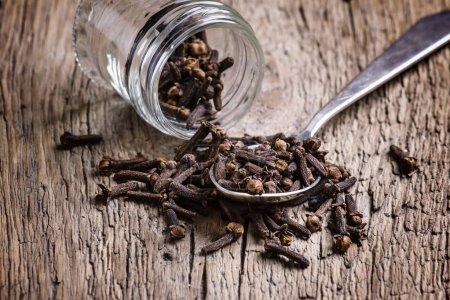 Cloves, old wooden background