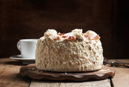 Meringue cake and a cup of coffee