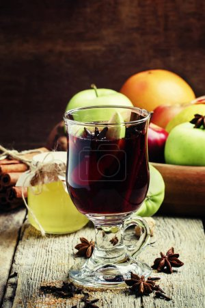 Hot mulled wine with apple and cinnamon