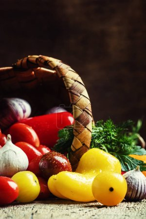 Colorful vegetables on a vintage wooden background