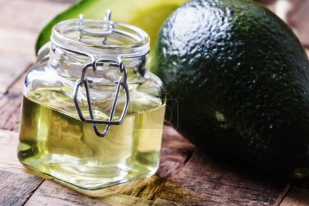 Cosmetic avocado oil in a glass jar