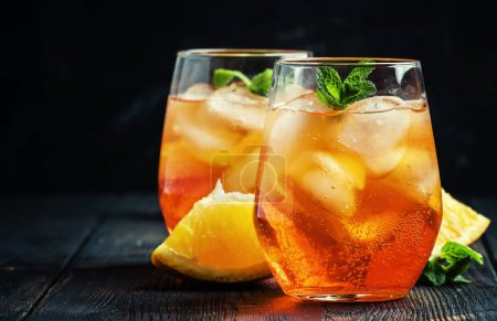 Photo for Aperol Spritz cocktail with ice, black background, selective focus - Royalty Free Image