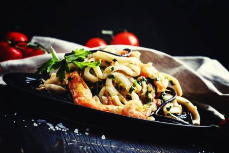 Black pasta with seafood and tomato sauce