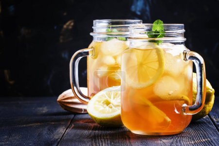 Ice black tea with lemon and mint