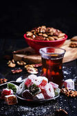 Oriental sweets with nuts and black tea