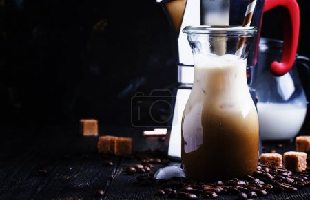 Cold iced coffee with milk and ice