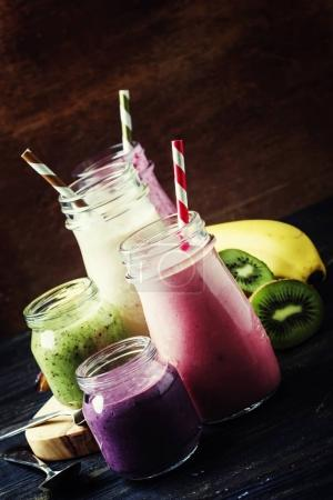 Multicolored milkshakes and berry smoothies