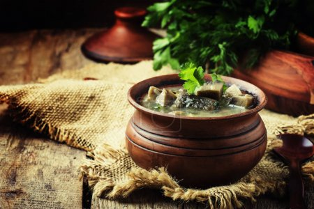 Mushroom soup in a clay pot