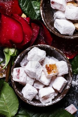 Oriental sweets with almonds and pink petals
