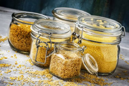 Photo for Assorted cereals and grains in glass jars for storage, selective focus - Royalty Free Image